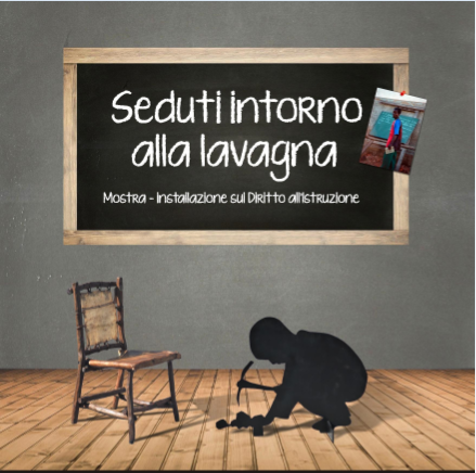"""Seduti intorno alla lavagna al CFSI in occasione del seminario """"Un mondo in classe"""""""
